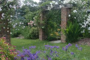 Garden pergola with brick pillars