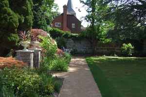 Tidy walled garden with path